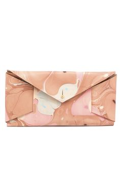 The Betty Clutch is perfectly sized to fit your cards and ID for the night along with your phone. Carry it out by itself, tucked under your arm or with your freshly painted black nails to glam up any