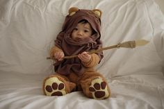 costume ewok:   I bought a teddy bear costume and made the other parts from an old brown t-shirt and boot laces. The spear was made carved from an old Lowes paint stick and a tree branch.
