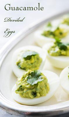Guacamole Deviled Eggs ~ Green deviled eggs! Hard boiled egg halves, stuffed with avocado guacamole. #StPatricksDay ~ SimplyRecipes.com
