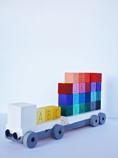 DIY Rainbow Wooden ABC Blocks and Truck for learning and fun. Cute handmade toy for kids to learn the alphabet, colors and numbers. Wood Projects For Beginners, Woodworking Projects For Kids, Diy Woodworking, Popular Woodworking, Sewing Projects, Diy For Kids, Gifts For Kids, Diy Toys Doll, Wooden Alphabet Blocks