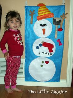 Play felt snowman kids can build again and again. I'm definitely making this next year.
