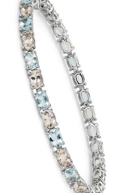 Perfect for spring, this bracelet features pastel morganite and aquamarine gemstones framed in 14k white gold.