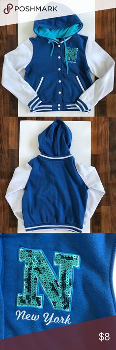 SWS Blue and White Varsity Junior Jacket This SWS Jacket is Blue with White Sleeves. It is a size XL. There is some loose threading near the button as shown in the picture. There are some marks on the white sleeve as shown in the last 2 pictures. Jackets & Coats