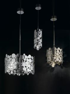 Small metal discs are formed into a pre-arranged design, and fused together to make this lovely ceiling pendant. It creates a beautiful display of light and shadow on your walls.  http://italian-lighting-centre.co.uk/modern/modern-gold-cylinder-ceiling-pendant-p-4601.html