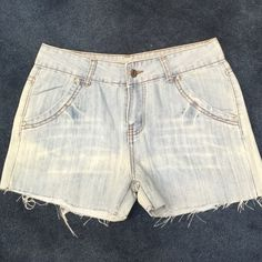 Lightweight denim distressed shorty shorts A lightweight style of denim shorty short distressed shorts. About mid rise. Fall at or little below belly button. Size 28 waist. Approx 2 inch from crotch to seam. 2 side seam unique design pockets on front and 2 pockets on back. Were too small for me. Never worn or washed. Cotton spandex Shorts Jean Shorts
