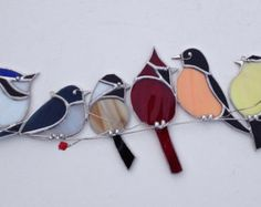 Favorite backyard birds ,Canadian Bird gang, on 3-D tinned wire branch with red berries stained glass sun catcher