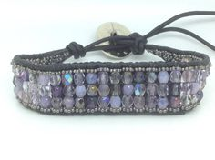 Finally a solution for the fashionable Fitbit Flex wearers! This striking Lavender and Silver bohemian chic leather wrap bracelet has a hidden genuine