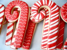 Candy cane decorated sugar cookie. Royal icing. Red, white. Marbled, stripes.