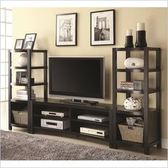 Coaster Curved Front Entertainment Center - A curve shape at the front of this entertainment wall unit adds intriguing style to its look. The TV console has an inverted curved while the media tower at each end curves out - together the set has a subtle yet eye-catching design. The console includes four shelves that give you plenty of room to add components for use with your TV. It accommodates widescreen TVs up to 60 inches.