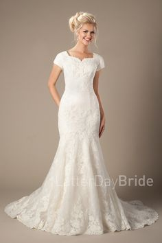 Galloway | Modest Lace Wedding Dress | LatterDayBride & Prom | SLC | Utah | Worldwide Shipping | This lovely lace modest gown features a unique lace pattern and mermaid silhouette.     Gown available in White, Ivory or Light Champagne/Ivory    *Gown pictured in Light Champagne/Ivory    Sleeve length or neckline can be customized.