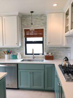 Final kitchen renovation. Luanda Bay Tile Agate Asolo offset brick backsplash, MSI perla white quartz, Benjamin Moore white dove uppers, Stratton Blue lower cabinets