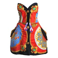 Very rare baroque fan printed couture dress designed by Gianni Versace dating to 1991 as seen on the runway and featured in Versace's fall of 1991 ad campaign. This dress has a sculptured shape and is made with fabric printed and seamed to tehe shape of the dress. Fabricated entirely of silk. Buttons are made of a heavy gilt metal with poured glass details