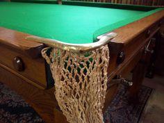 Antique billiards table, pocket detail.