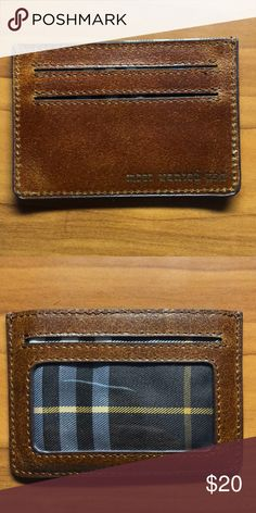 Leather ID/card holder Barely used card holder from NYC leather maker Most Wanted USA.  Has see through pocket for ID, two card slots, and a middle pocket for bills.  Brown leather with plaid interior.  Used twice, no signs of wear. Most Wanted USA Accessories Key & Card Holders