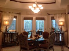 Dining room with matching mirrored buffets.