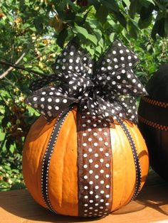 This is very easy and far less expensive than bejeweled pumpkins! Just don't use a huge pumpkin bc you have to keep tipping it over to pin ribbon in.