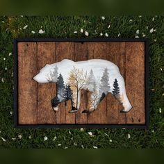 """A beautiful piece created on reclaimed wood of a bear and within' the cutout is a foggy Autumn morning. And to bring it all together, a crisp black frame. Measures at 16""""x24"""". Woodworking and painting all in one."""