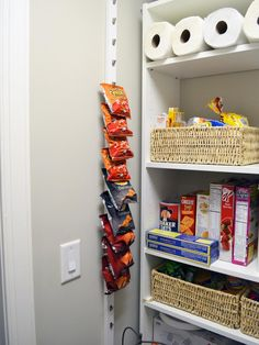A narrow strip of wall space is the ideal spot for single-serving bags. To create her custom holder, Christy at 11 Magnolia Lane glued curtain hooks (minus the rings) to a strip of painted wood.