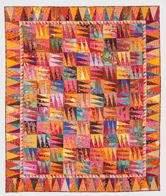 """Hot Flash"" by Jan Lewis, West Michigan Quilters Guild. 2012 AQS Quilt Show, Grand Rapids. Posted by Kirsetin Morello at ExperienceGR. Pattern from the cover of Glorious Patchwork by Kaffe Fassett"