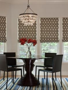 Chandelier & window treatments + red accent color - Dining Room
