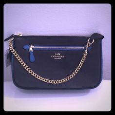 """Coach NWT Color-Block Nolita Chain Wristlet Absolutely GORGEOUS BNWT 100% Guaranteed Authentic 3-in-1 Wristlet/Shoulder/Clutch Bag from Coach.  A stunningly versatile MUST-HAVE bag for the upcoming Spring/Summer season, crafted in finely pebbled leather boasting shades of Peacock and Navy Blue. This bag can hold a tablet and other essentials and can be carried as a wristlet OR worn on the shoulder OR tucked into a larger bag. Zip-top closure, fabric lining, outside zipper pocket. 9 1⁄4"""" (W)…"""