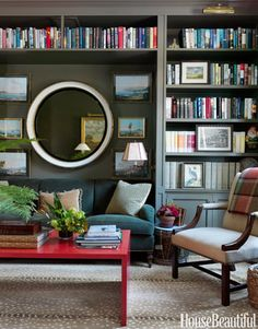 """A coffee table from Gerald Bland """"adds the pop of red every room needs,"""" Newberry says."""