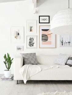 Although gallery walls have been trending for awhile, there's no need for your own art collection to feel stuck in the same old rut. You can keep the look feeling light, bright, and airy simply by limiting your color palette and keeping the surrounding furniture and accessories minimalistic.