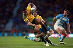Australia's Israel Floau breaks through the Argentinean defence