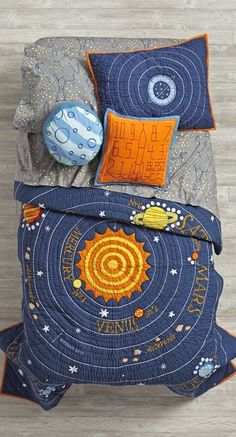 "Let the countdown to bedtime begin. Our out-of-this-world Solar System quilt features our eight official planets orbiting the sun. Feeling sorry for Pluto? We've paid homage to the cute dwarf planet in a top-of-the-bed, reversible throw pillow. Complete the universe with our Stars and Orion's Sheet Sets. Don't forget a ""Blast-Off"" throw pillow."