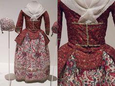 Girl's ensemble of red ground chintz jacket and chintz skirt. Fabric jacket: India, 1725-1775, jacket ca. 1760.