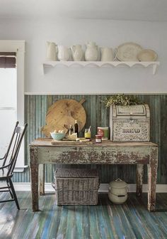 High shelf with cream crockery and rustic table