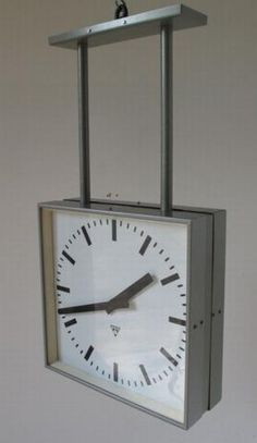 Communist era double-sided hanging station clocks by Pragotron, salvaged in the Czech Republic. Fitted with new battery movements.