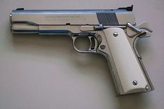 Colt 45 1911-matte black with crome handle inlay...my dream.