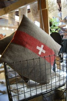 Pillow cover from a vintage wool Swiss Army blanket. Yes please.