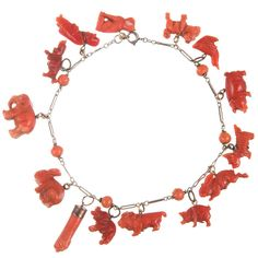 Carved Coral Charm Bracelet | From a unique collection of vintage charm bracelets at http://www.1stdibs.com/jewelry/bracelets/charm-bracelets/