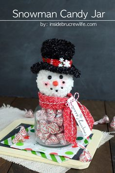 Snowman Candy Jar - a snowman head ornament glued to a jar filled with candy makes a cute candy jar