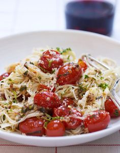 Tomatoes and basil give this dish the perfect amount of flavor. Recipe: Capellini with Tomatoes and Basil   - HouseBeautiful.com
