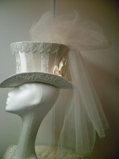 This is the hat I always wanted to wear for my wedding. It's perfect. My neck isn't that long... You can't have it all.
