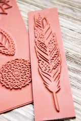 pretty handmade feather stamp--hand make your own with with erasers for pendant size pieces or linoleum for larger stamps. Carving into a recently hardend plaster block. Let plaster dry out before first use--do not over use the block. When the plaster soaks up the moister from clay or polymer let it dry out before using again. Use a linoleum cutter and exacto knife to carve your blocks/stamps.