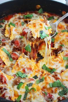 Cheesy Ravioli and Italian Sausage Skillet via The Comfort of Cooking. Pure comfort food right here! This looks awesome!