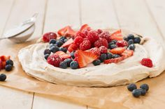 Chocolate Chunk Pavlova with Spiced Whipped Cream and Red Berries is a perfect Valentine's Day treat!