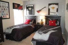 """Music Themed Toddler Room -- This pin actually redirects to a website to buy vacation homes I think, but I wanted to pin it anyway to remember the framed Hard Rock T-Shirts. I love this!   Maybe take aa's House of Blues, and various band """"Onsies"""" that we had made and frame those for his Toddler/Kid's Room!"""