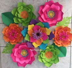 Handmade paper flower set. Perfect for birthdays, or any event. Made to order. Takes me 5 days to make from ordering date. Shipping is 5-7 days after flowers are made. Turn around time is 1-2 weeks from ordering date. 7 piece paper flower set Flowers ranging from 8-16. Flowers