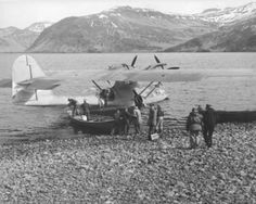 This sight might have been similar to the crew of the S-27. While it was taken in Unalaska Island, it shows another Catalina using a dory to load and unload passengers and cargo. Alaska Digital Archives.