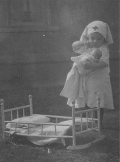 Oh My .... This may just be my New Favorite Child Photo! (Definitely a Top 5) .... Shared to me By Viewer Mandie of her Friends Mother from 1915 who was 3 at the time.  She later Went on to become a Nurse in real Life  ..... Hoping to provide an about location soon  ...... Love it!    Edit : Just Found out that she was from NW Oregon and her Name was Florence ..... How Appropriate!