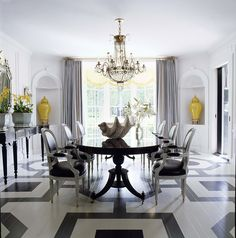 Gray, white, and yellow gold dining room. Stenciled floors.   Interior Design by Mary McDonald of Million Dollar Decorators Photo 2