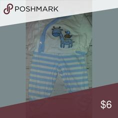 GERBER 3 pc set 0-3m 2 piece pajama.  Long sleeve white cross snap shirt with giraffe. Matching blue and white striped pants Striped hat Pants has some orange...pic 2  Add items to bundle and save. $2 off list price when purchasing 2 or more items. Gerber Pajamas Pajama Sets