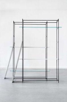 Black steelwork structure/clothes rack via the minimalist.