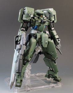 Custom model kit using various parts from multiple model kits, modeller has stuck to a similar colour scheme to the orginal base kit, which gives the model a mitaristic appearance Gundam Toys, Gundam Art, Transformers, Gundam Iron Blooded Orphans, Big Robots, Mecha Suit, Gundam Wallpapers, Gundam Custom Build, Lego Mecha