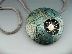Modern organic statement pendant necklace of polymer clay with flower and crystal detail